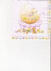 Bábätko v kočiariku na ružovom podklade