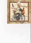 kuchárik na bicykli na zlatom podklade